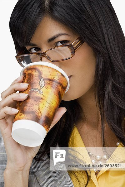 Portrait of a young woman drinking cold drink