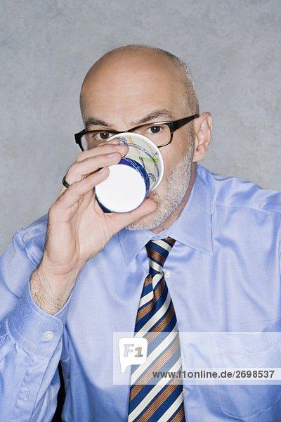 Portrait of a businessman having a drink