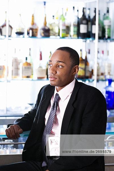 Close-up of a businessman at a bar counter