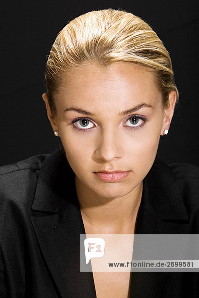 Portrait of a young woman looking serious