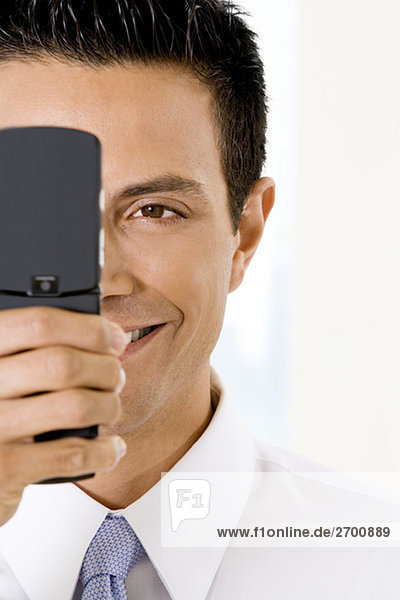 Close-up of a businessman holding a mobile phone