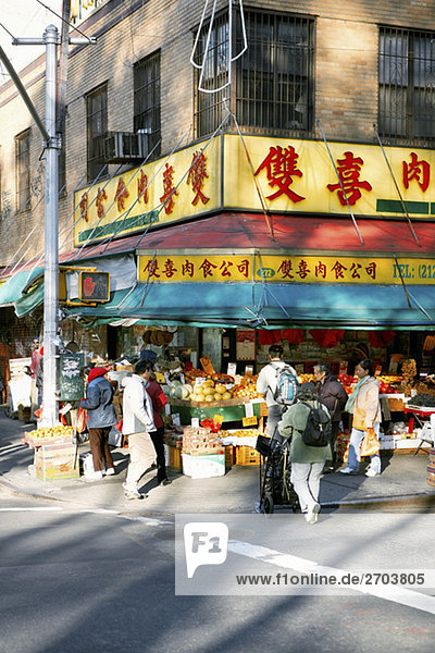 Group of people in a fruit market  Chinatown  Manhattan  New York City  New York State  USA