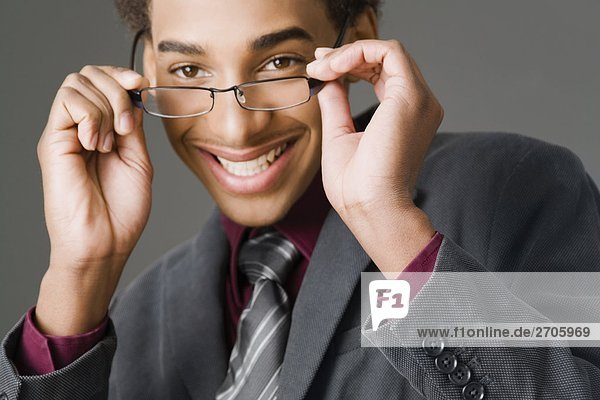 Portrait of a businessman wearing eyeglasses and smiling
