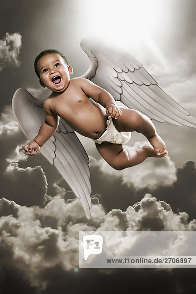 Low angle view of a baby boy flying