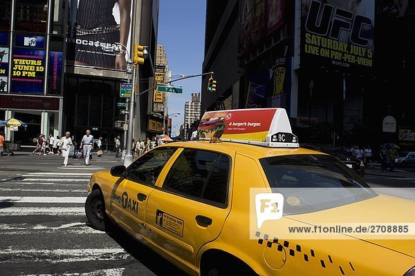 Yellow taxi on the road  Times Square  Manhattan  New York City  New York State  USA