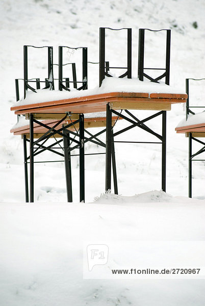 Germany  Allgaeu  Snow-covered table and cars