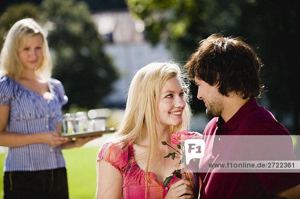 Germany  Bavaria  Upper Bavaria  Young couple in beer garden  portrait