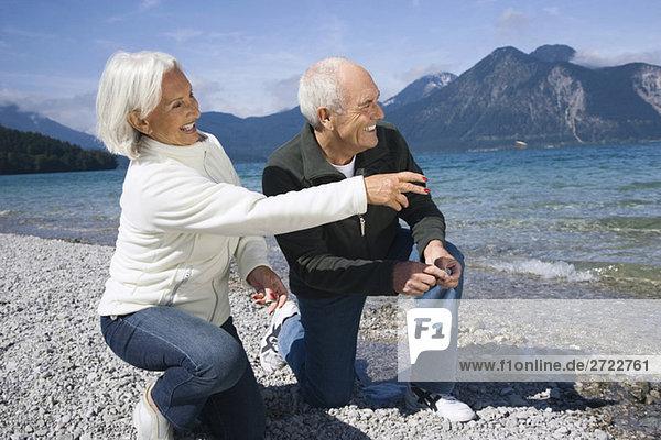 Germany  Bavaria  Walchensee  Senior couple looking across lake