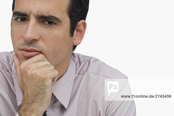Portrait of a businessman thinking with his hand on his chin
