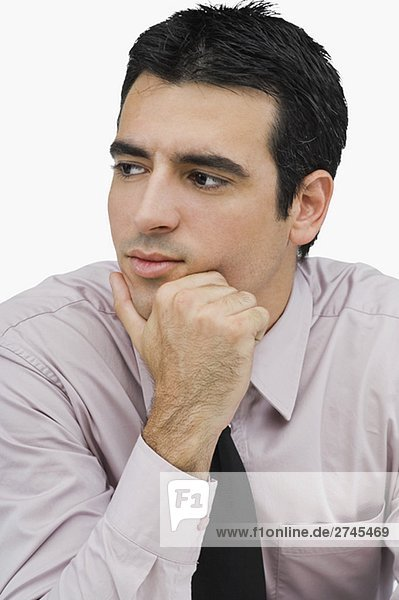Close-up of a businessman thinking with his hand on his chin