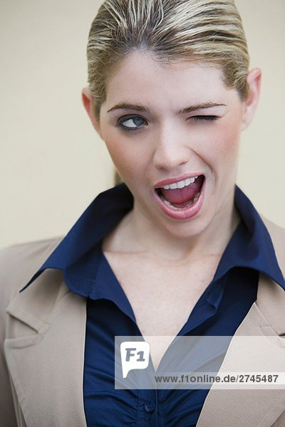 Close-up of a businesswoman winking
