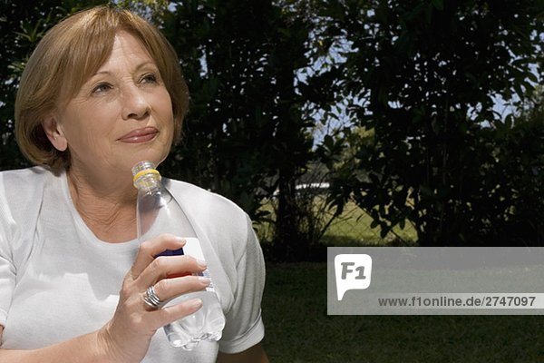 Close-up of a senior woman drinking water