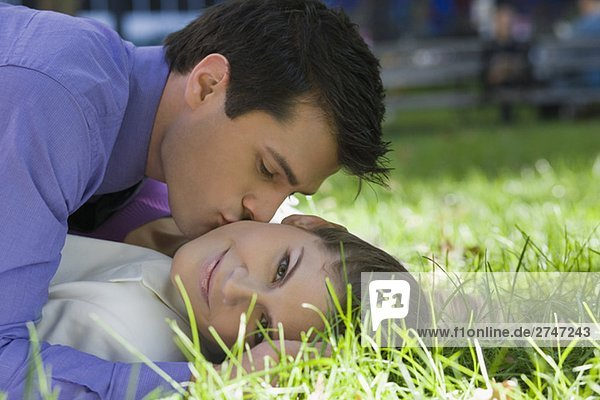 Young couple romancing in a park