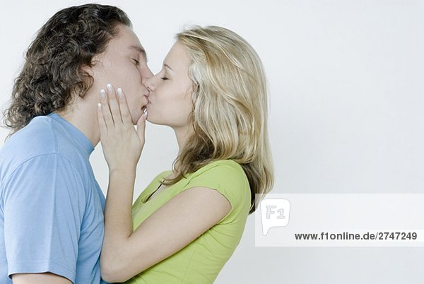 Close-up of a young couple kissing to each other
