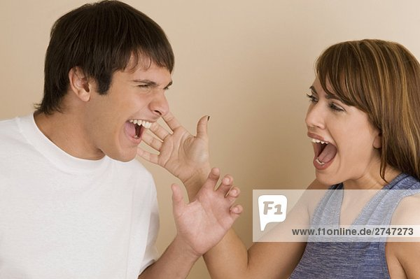 Close-up of a young couple laughing