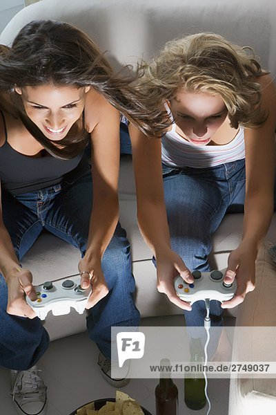 High angle view of two young women playing a video game together