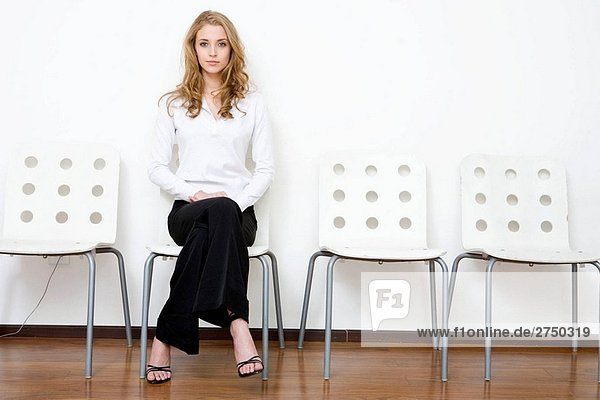 business woman sitting and waiting
