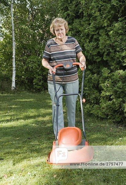 Woman cutting the lawn