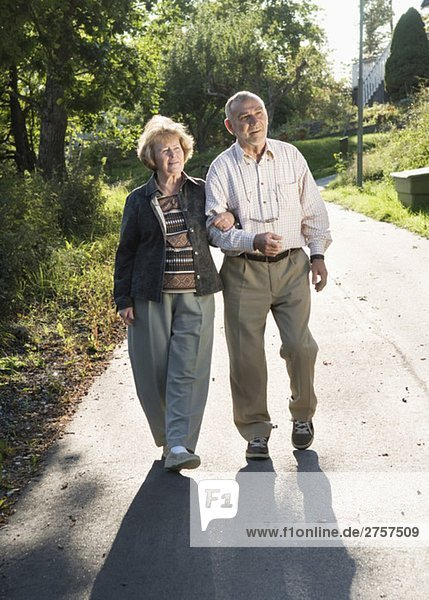 Elderly couple arm in arm Elderly couple arm in arm
