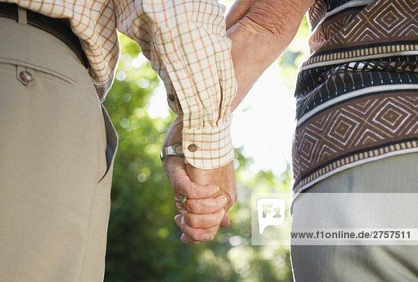 Elderly couple holding hands Elderly couple holding hands