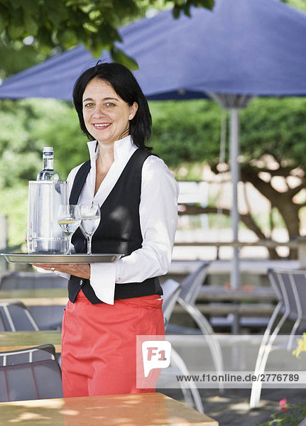 Portrait of a waitress with drinks