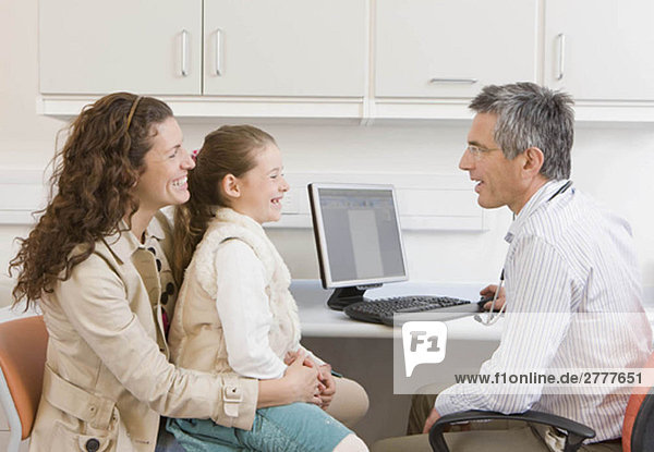 A mother and daughter visit the doctor