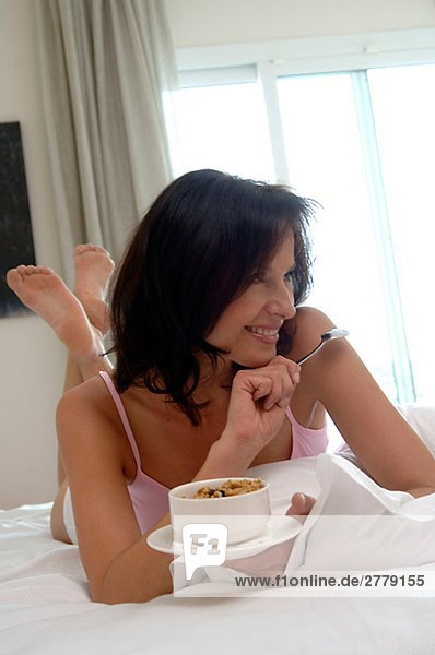 Woman with muesli for breakfast