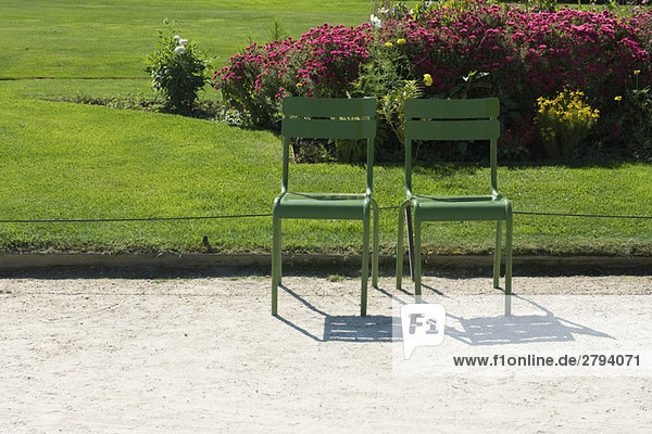 France  Paris  metal chairs set side by side in park