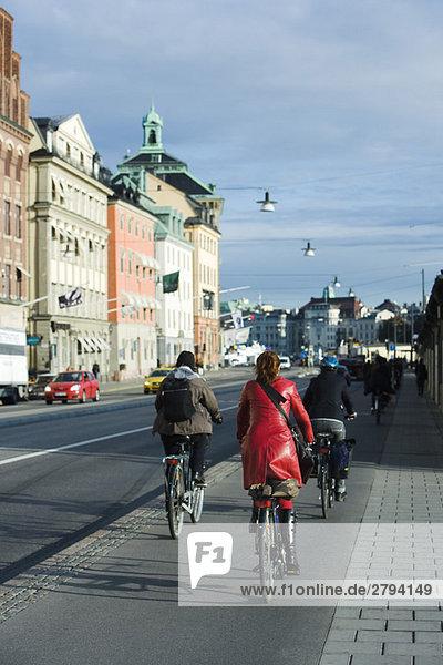 Sweden  Sodermanland  Stockholm  bicyclists riding on sidewalk