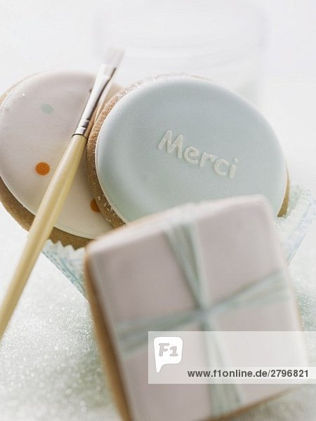 Assorted iced biscuits  paintbrush for decorating