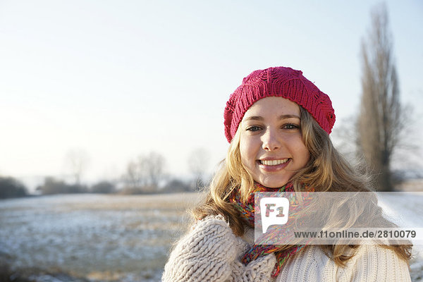 Portrait of woman smiling in warm clothing