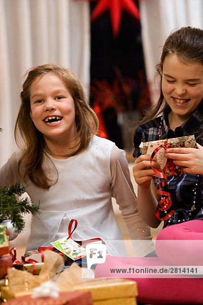 Two sisters at home during Christmas time Sweden.