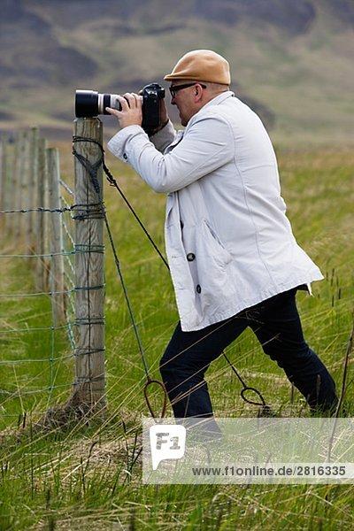 Ein Mann Fotografieren Island.