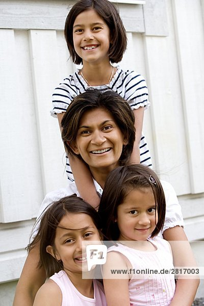A mother with three daughters.