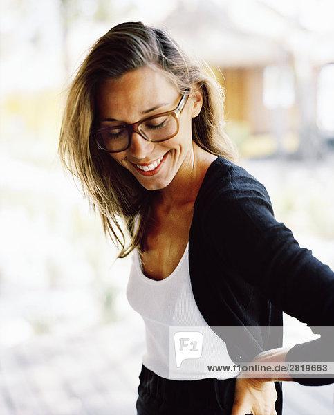 Portrait einer Frau mit Brille.