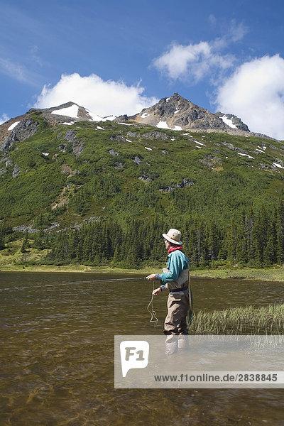Flyfisherman at Silvern Lake  Smithers  british columbia  canada.
