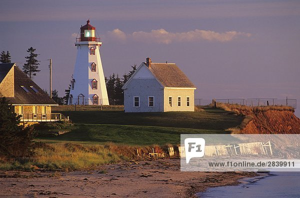 Lighthouse at sunset in Panmure Island Provincial Park  Prince Edward Island  Canada.