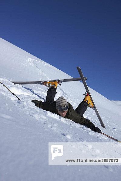 Male skier fallen over