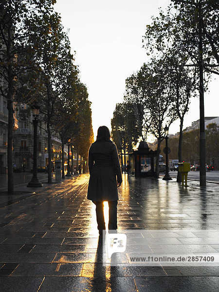 Woman walking on Champs Elysees
