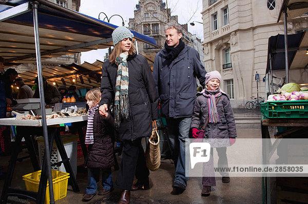 Family walking in outdoor market