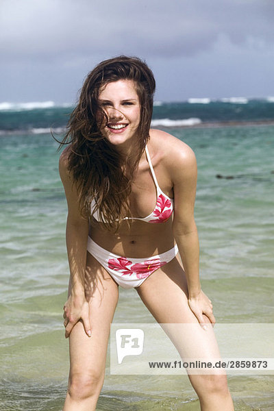 Young woman on beach  smiling  portrait