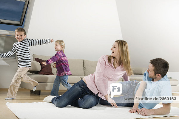 Family relaxing at home  children frolicking