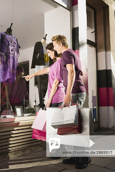 Germany  Munich  Couple window shopping