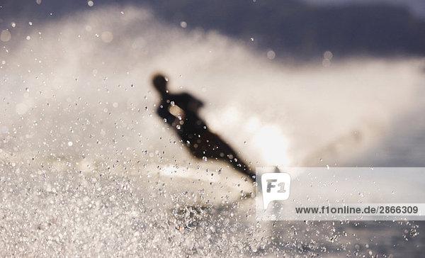 Austria  Salzkammergut  Lake Mondsee  Water-skier  silhouette (blurred motion)