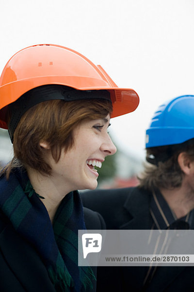 Project leaders at a building site a man and a woman Sweden.