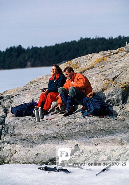 Long distance skater sitting on a cliff Sweden.