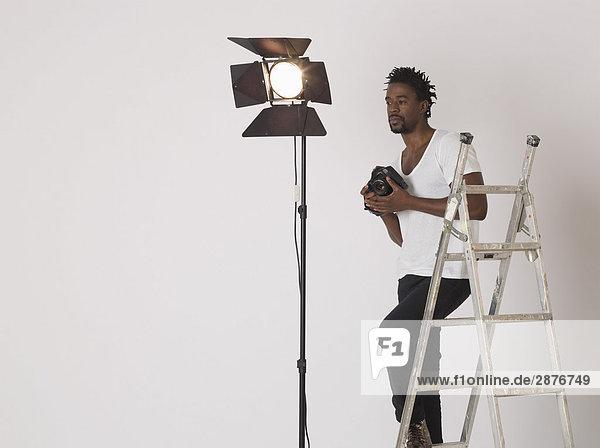 Mittelalter (30-35 Jahre) Fotograf in Studio
