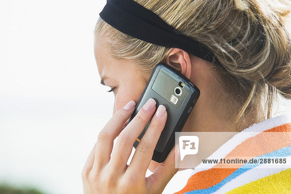 Close-up of a woman talking on a mobile phone