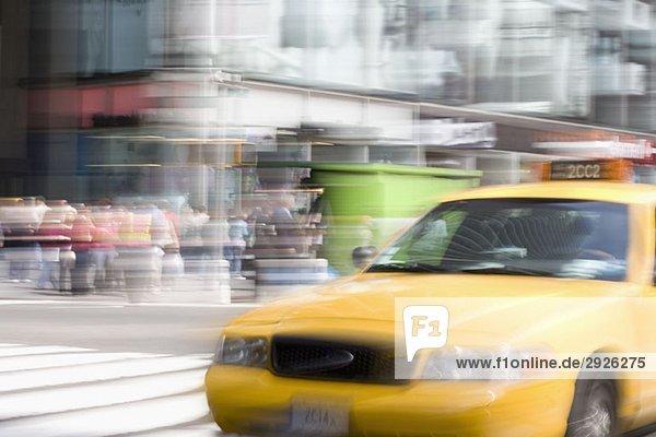A yellow taxi on a city street  Manhattan  New York City
