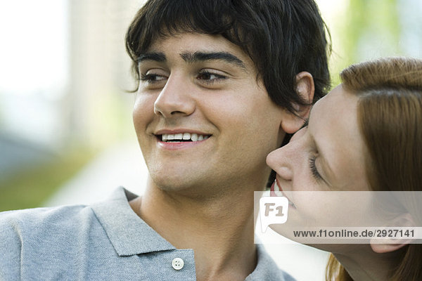 Young couple smiling  flirting  close-up